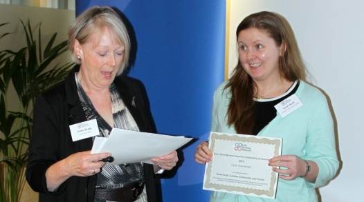 Gillie presenting commendation to Sarah